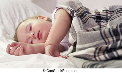 Peaceful child being in bed sleeping comfortably