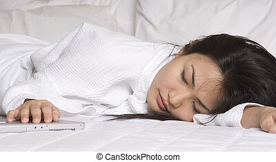 Asleep - A young asian woman sleep with one hand on her...