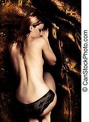 asleep - sensual young woman asleep, golden brown...