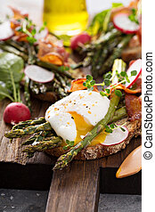 Asparagus and bacon bruschetta with poached egg
