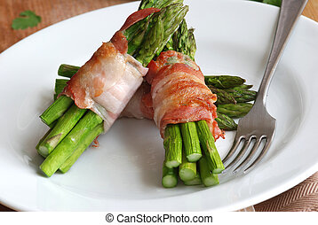 Asparagus and pancetta wraps on a plate