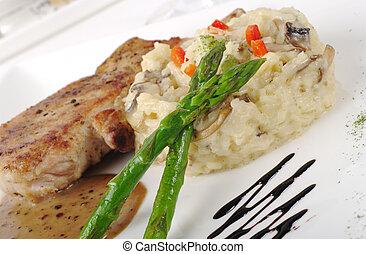 Main dish: Chop with sauce, rice and asparagus (Selective Focus)