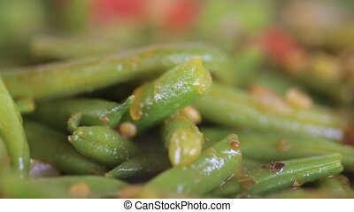Asparagus beans are fried close-up
