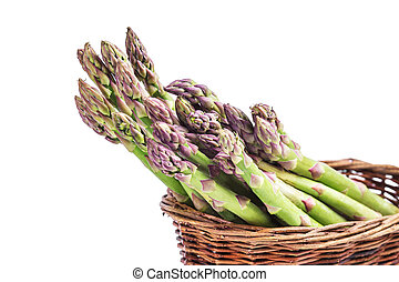 Asparagus in basket isolated on a white background