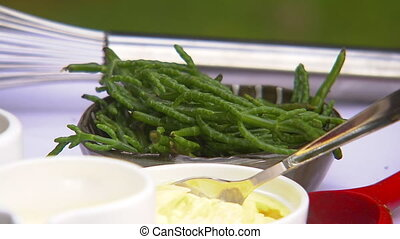 Asparagus on a brown bowl