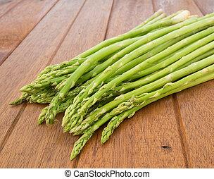 asparagus on wood background