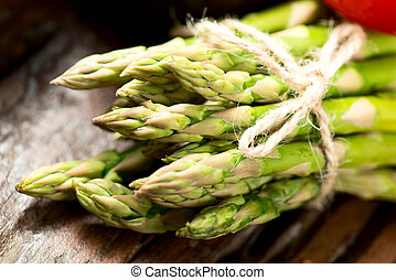 Asparagus on wooden table close up - Asparagus on wooden...