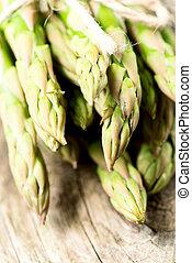 Asparagus on wooden table closeup