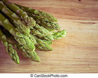 asparagus on wooden table with filter effect retro vintage style