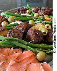 Asparagus salmon, onlives and meatballs