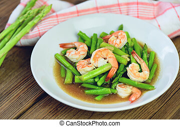 Asparagus Shrimp Seafood Cooked Health Food - Stir fried shrimps with asparagus green on white plate and wooden table background