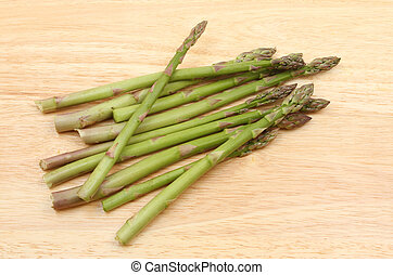 Asparagus spears on a board
