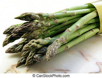 Asparagus - A bunch of fresh asparagus isolated on white...