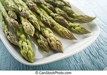 Asparagus - Bunch of fresh asparagus on a plate close up