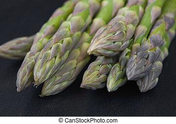 Asparagus - Bunch of green asparagi on dark back ground