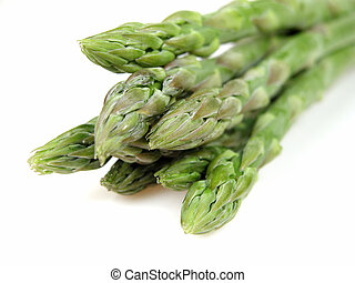 Asparagus over white background with selective focus.