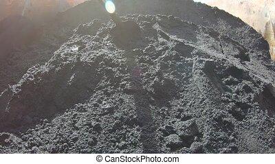 Asphalt bitumen in a dump truck - In an open iron body of a...