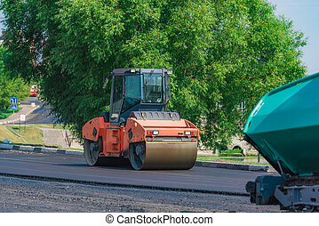 asphalt compactor on the road - Roller machine rolls fresh ...