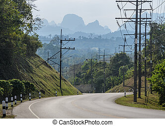 Asphalt curve road with mountain background