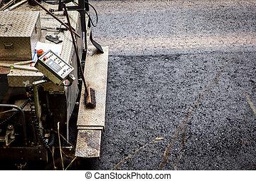 asphalt finisher, paver constructing a asphalt road -...