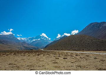 Asphalt mountain road in the Himalayas, Nepal. - Asphalt...