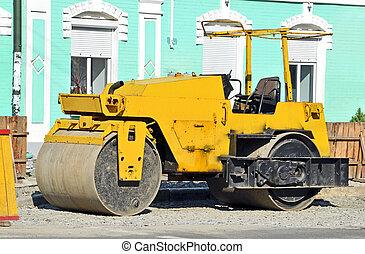 Asphalt paver on road construction site