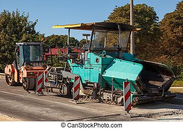 Asphalt paving machines