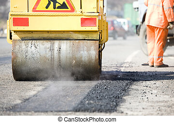 Asphalt paving works with compactor