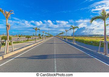 Asphalt road and blue sky