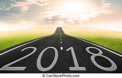 Asphalt road and sky background with 2018 words, Business concept in 2018.