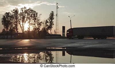 Asphalt road at the sunset