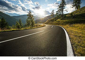 Asphalt road in Austria, Alps in a summer day.