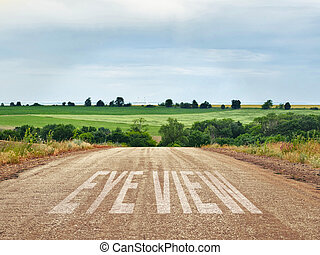 Asphalt road in countryside. Natural skyline with green of landscape.
