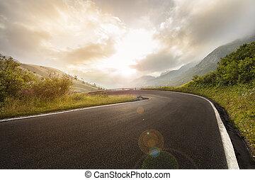 Asphalt road in Dolomites in a summer day.