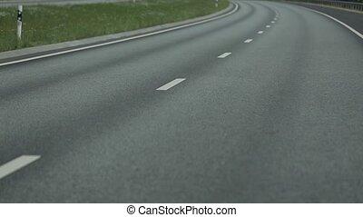 Asphalt road in motion summer time - Asphalt road in motion...