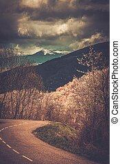 Asphalt road in Pyrenees mountains