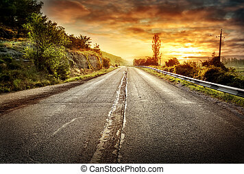 Asphalt road receding into a distance