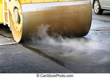 Road roller wheel close up working on the new asphalting