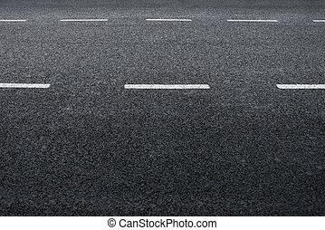 Asphalt road, detail of fresh new traffic road.