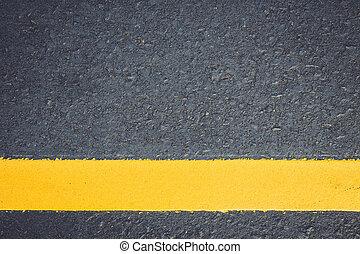 Asphalt road texture with yellow stripe
