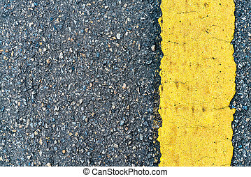 Asphalt road texture with yellow line