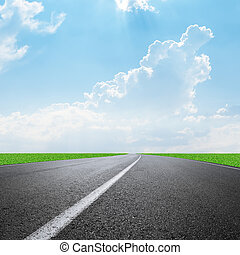 asphalt road to horizon and clouds on sky