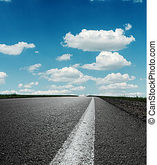 asphalt road under blue cloudy sky