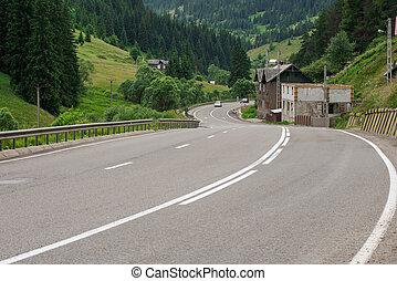 Asphalt road winding through flower hills in Romania