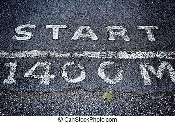 asphalt road with  start sign
