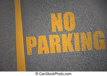 asphalt road with text no parking near yellow line.