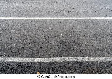 Asphalt road with white sign line