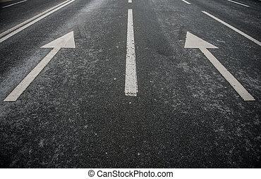 Asphalt road with white stripes