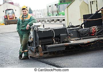 asphalt road worker - happy road construction worker near...