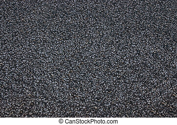 Asphalt roadway with a rough dark surface .Texture or background.